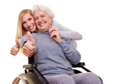 young and elderly woman doing thumb up